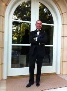 Keith Springer at Crocker Gala in front of the french doors