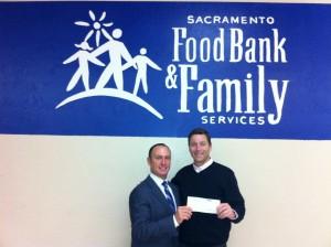 Keith Springer Donates to SacFoodBank12-10