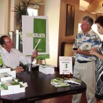 Keith Springer gives free copies of book Facing Goliath at Party