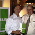 Keith Springer with client and new book Facing Goliath