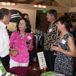Keith Springer talks with friends at Facing Goliath Book Signing Party