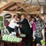 Keith Springer shakes hands at Facing Goliath Book Signing Party