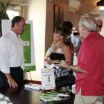 Top Sacramento Financial Advisor Keith Springer signs copies of Facing Goliath