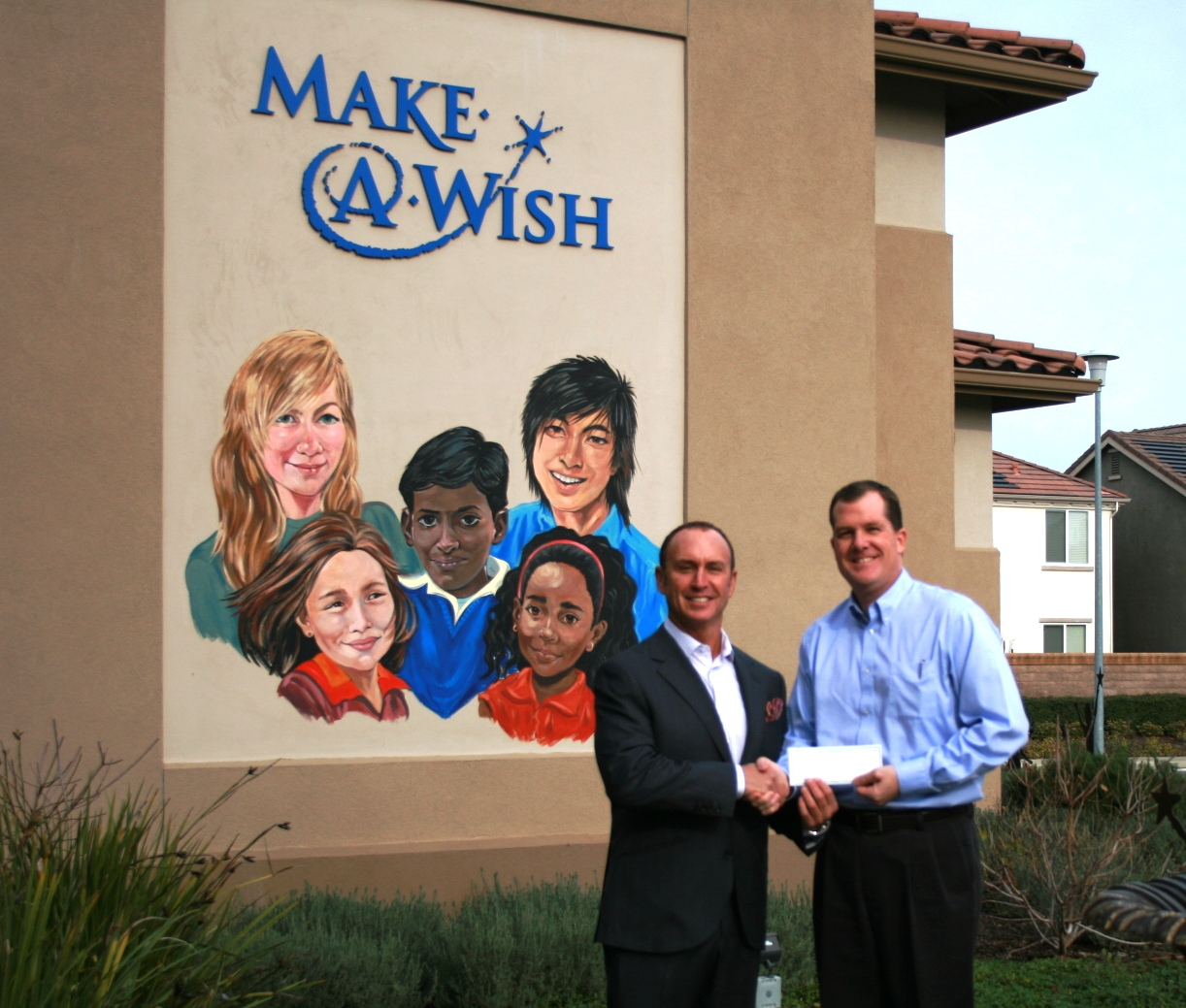 Keith Springer presents check to Make-A-Wish